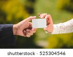 bride and groom with white card ...   Shutterstock . vector #525304546