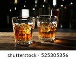 glasses of whisky on wooden bar ... | Shutterstock . vector #525305356