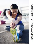 young sportswoman stretching... | Shutterstock . vector #525308806