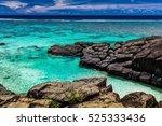 black rock  a tropical beach... | Shutterstock . vector #525333436