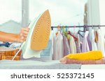 closeup of woman ironing... | Shutterstock . vector #525372145