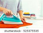 closeup of woman ironing... | Shutterstock . vector #525375535