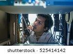 man troubleshooting in data... | Shutterstock . vector #525414142