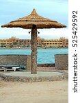 palm sea beach umbrellas made... | Shutterstock . vector #525429592