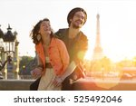 young couple visiting paris | Shutterstock . vector #525492046