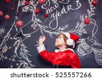 little boy dressed as santa... | Shutterstock . vector #525557266