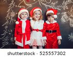 Children Dressed As Santa Clau...