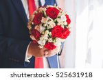 wedding bouquet in hands of the ... | Shutterstock . vector #525631918