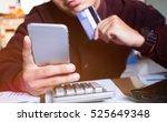 man hands using smartphone and... | Shutterstock . vector #525649348