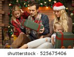young family watching christmas ... | Shutterstock . vector #525675406