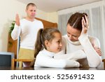 mother gives solace to crying... | Shutterstock . vector #525691432