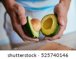 fresh avocado cut in half | Shutterstock . vector #525740146