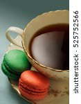 Small photo of Macaroons accompany a cup of tea in this photo.