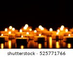 Many Burning Candles With...