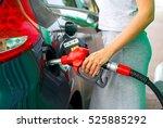 woman fills petrol into her car ... | Shutterstock . vector #525885292