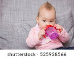 baby girl drinking water from... | Shutterstock . vector #525938566