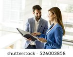 two young business people... | Shutterstock . vector #526003858