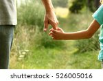 the parent holds the hand of a... | Shutterstock . vector #526005016