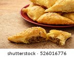 Small photo of Puff pastries with meat (samosa) - traditional uzbek and indian pasrty.