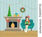 festive girl opening a gift at... | Shutterstock .eps vector #526039732
