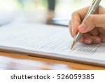 hand with pen over application... | Shutterstock . vector #526059385