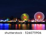 carnival at night with a ferris ... | Shutterstock . vector #526075906