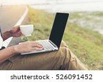 Smart Man Working On Laptop An...
