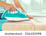 closeup of woman ironing... | Shutterstock . vector #526102498