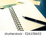 notepad and pen | Shutterstock . vector #526158652