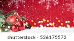 toy balls on red snowy... | Shutterstock . vector #526175572
