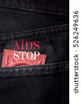 Small photo of condom pack in back pocket jeans,Image for World AIDS day or abortion concept.