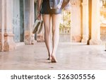 asian woman holding shoes and... | Shutterstock . vector #526305556