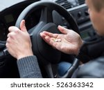 man takes drugs in the car | Shutterstock . vector #526363342