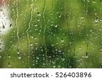 Rain Drops On Window With Gree...
