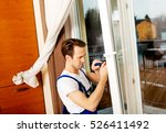 young handyman repair window... | Shutterstock . vector #526411492