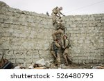 Group of rangers team climbing from a wall - stock photo