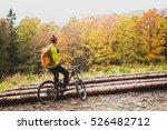 mountain biker looking at... | Shutterstock . vector #526482712