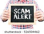 scam alert   man holding small... | Shutterstock . vector #526504462