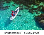 fisherman catches a fish on a... | Shutterstock . vector #526521925
