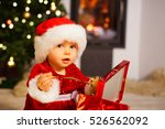little baby girl with santa hat ... | Shutterstock . vector #526562092