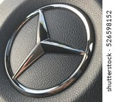 Small photo of FOLSOM, USA - NOV 30, 2016: Crome Mercedes Benz Metal logo on car wheel in a black leather texture.