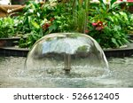 Small Fountain in the city park - stock photo