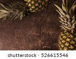 Two Ripe Pineapple Lying On A...