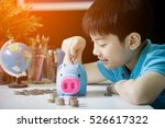 Little Asian Boy Insert Coin...