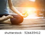 close up hands. woman do yoga... | Shutterstock . vector #526635412