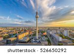 Stock photo aerial wide angle view of berlin skyline with famous tv tower at alexanderplatz and dramatic clouds 526650292