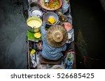 woman in boat prepares food at... | Shutterstock . vector #526685425
