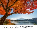 Stock photo mount fuji with beautiful color maple leaves and tree at lake kawaguchiko japan 526697896