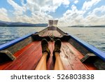 male's feet relaxing on a boat. | Shutterstock . vector #526803838