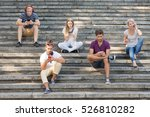 People Sitting On City Stairs ...